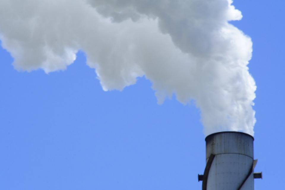 Smoke stack against a blue sky