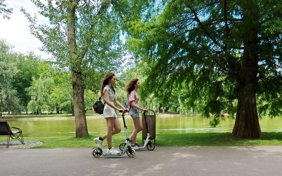 Image: Women riding scooters